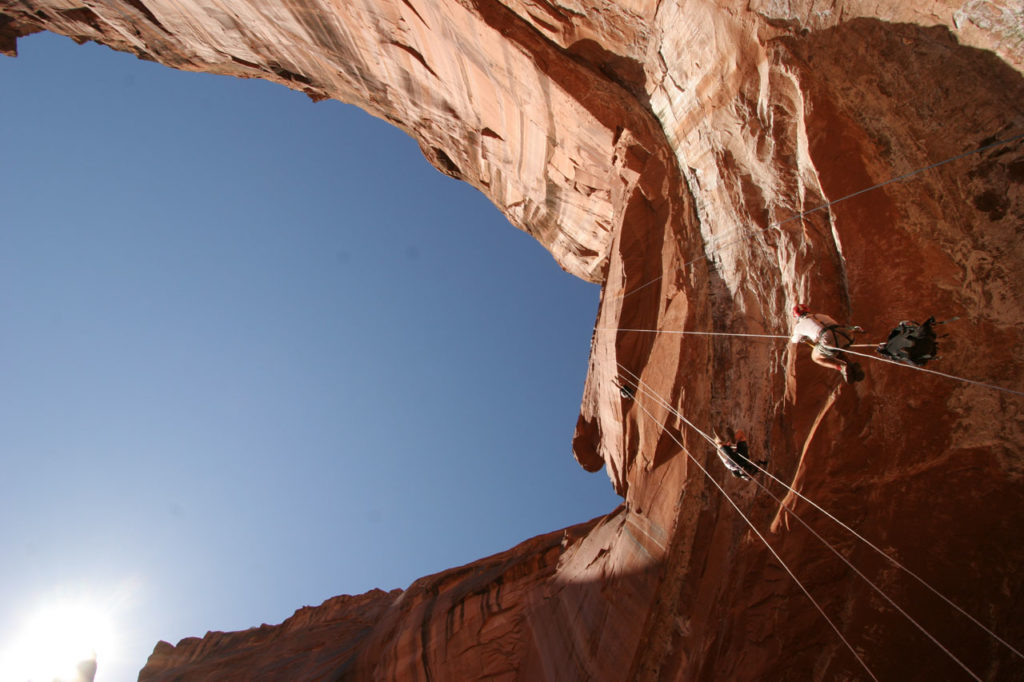 View of a team rappelling from below