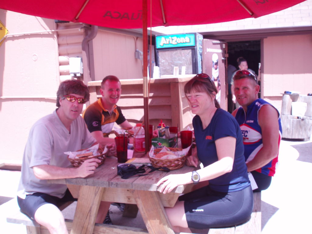 Team TravelCountry/Tango at a picnic table on a restaurant deck in Colorado during a training weekend