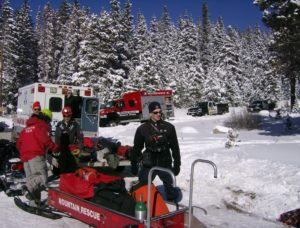 Mountain rescue team members and equipment stage at command
