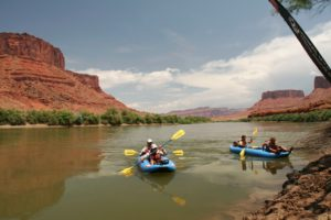 Team in two rubber duckies on final paddle in the Colorado River