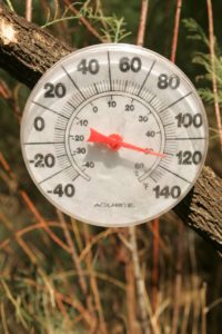 A thermometer shows a temperature of 120 degrees F.