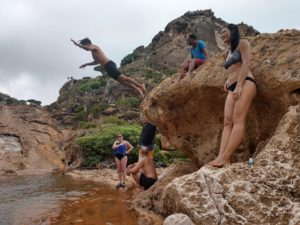 Swimming and cliff diving in the infinity pool