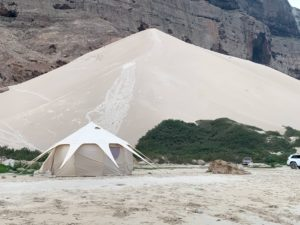 The Dragon's Nest tent set up on the beach