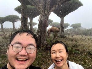 TK and Karen smiling in the rain during camel trek