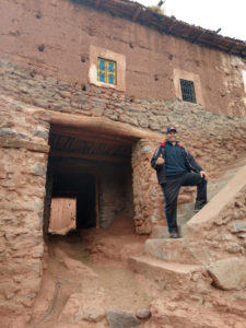 Rachid posing in front of Berber buildings